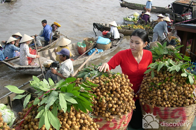 Boat of longans in Cai Be floating market - Mekong delta tour