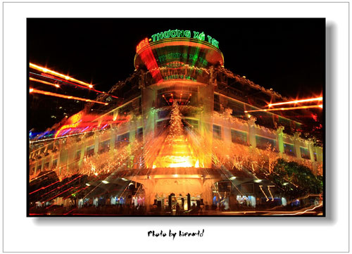 Saigon Tax Trade Center colorful at night - Ho CHi Minh City Travel Guide